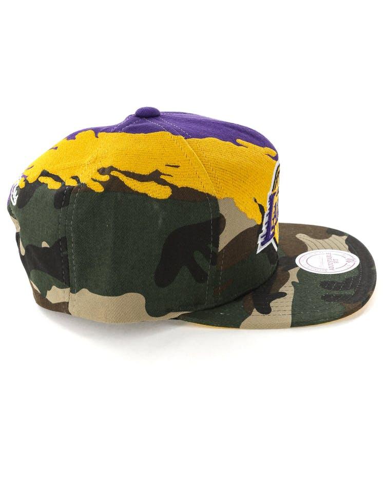 premium selection a3c80 3f52f Mitchell   Ness Los Angeles Lakers Camo Paintbrush Snapback Yellow Purple