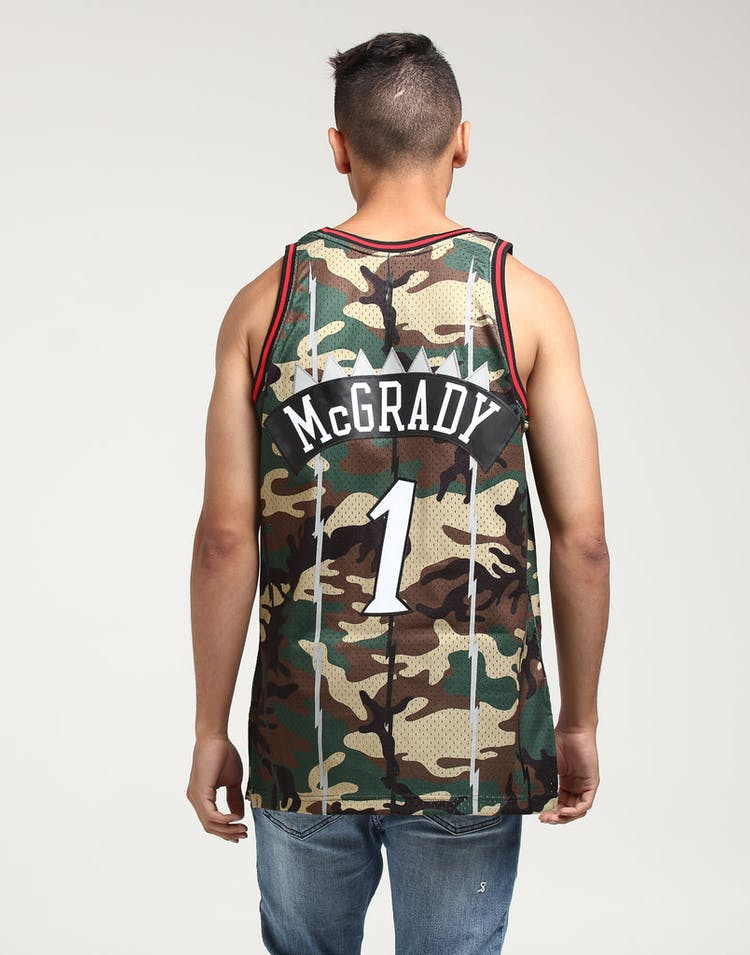 bcd30a9d8168 Mitchell   Ness Toronto Raptors Tracy McGrady  1 Swingman NBA Jersey Camo
