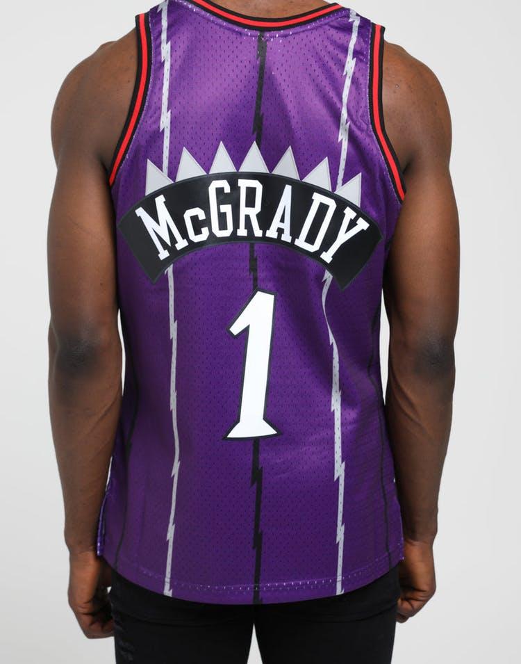 the latest 796f9 8b6e2 Mitchell & Ness Toronto Raptors Tracy McGrady #1 NBA Swingman Jersey  Purple/Red