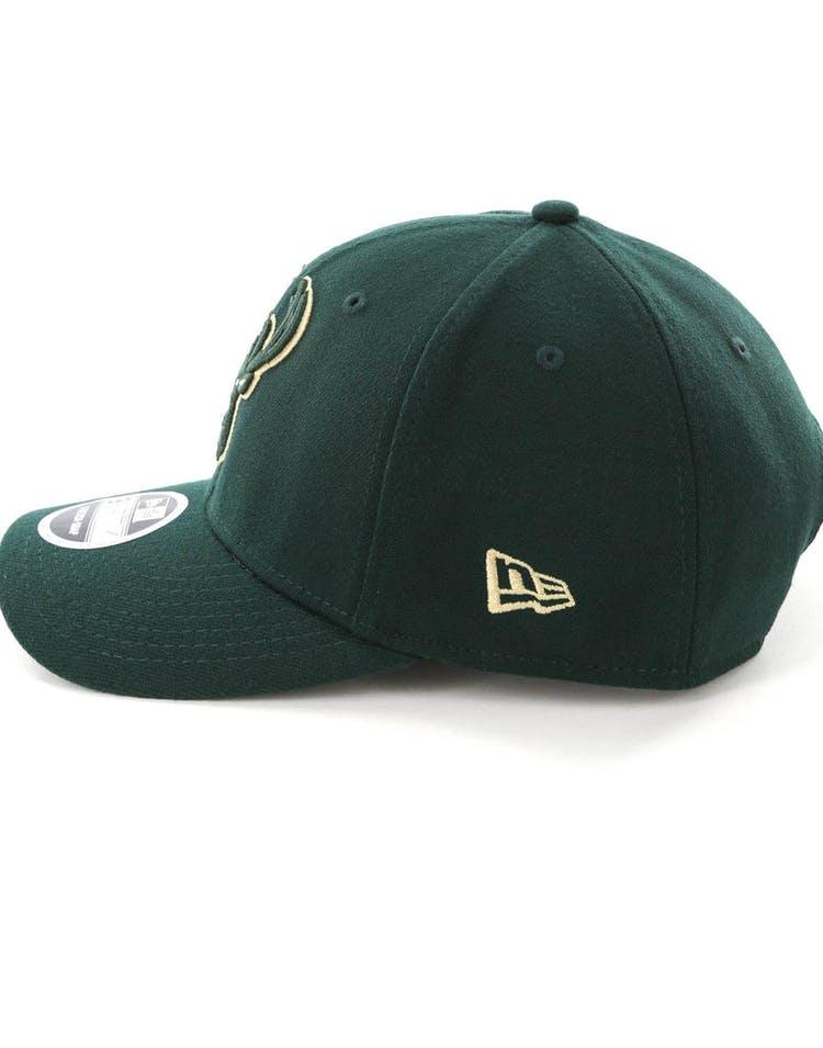 quality design ed0fd 9bf2b New Era Milwaukee Bucks 9FIFTY Stretch Snapback OTC Dark Green
