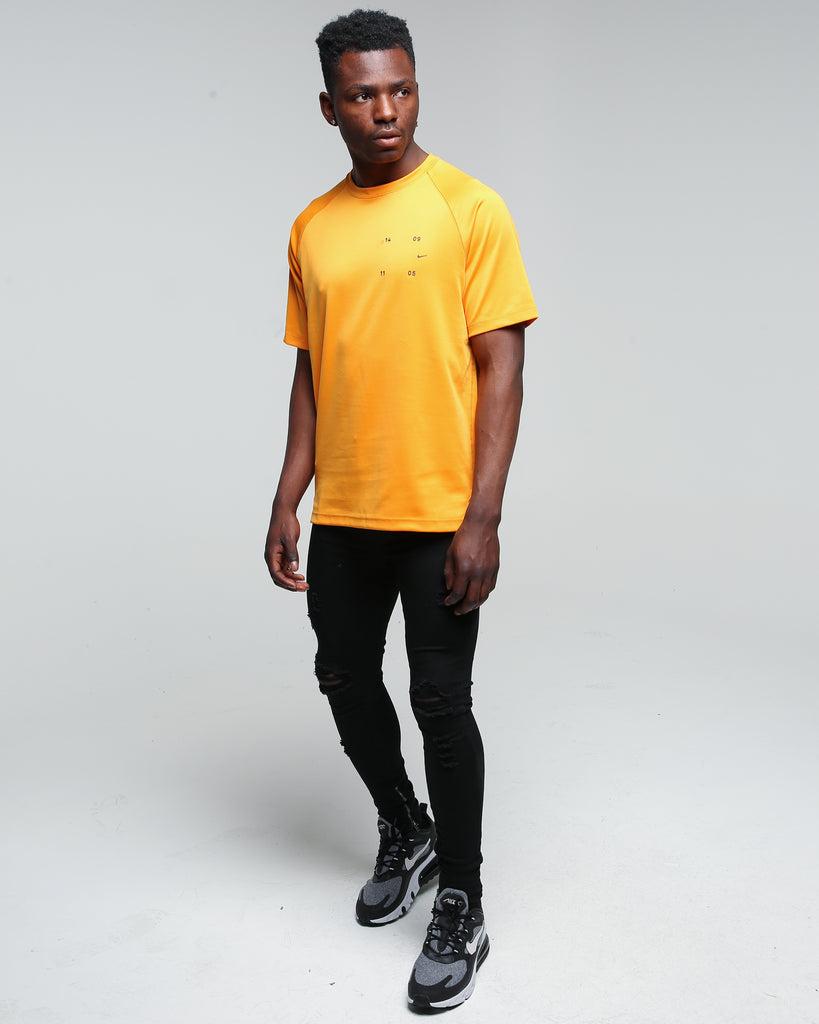 nike sportswear kumquat