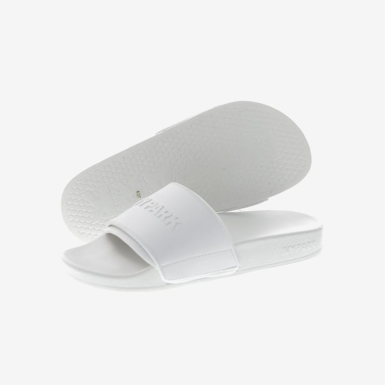 3f4c88c34d9bbe Ivy Park Neo Lined Embossed Logo Slides White – Culture Kings