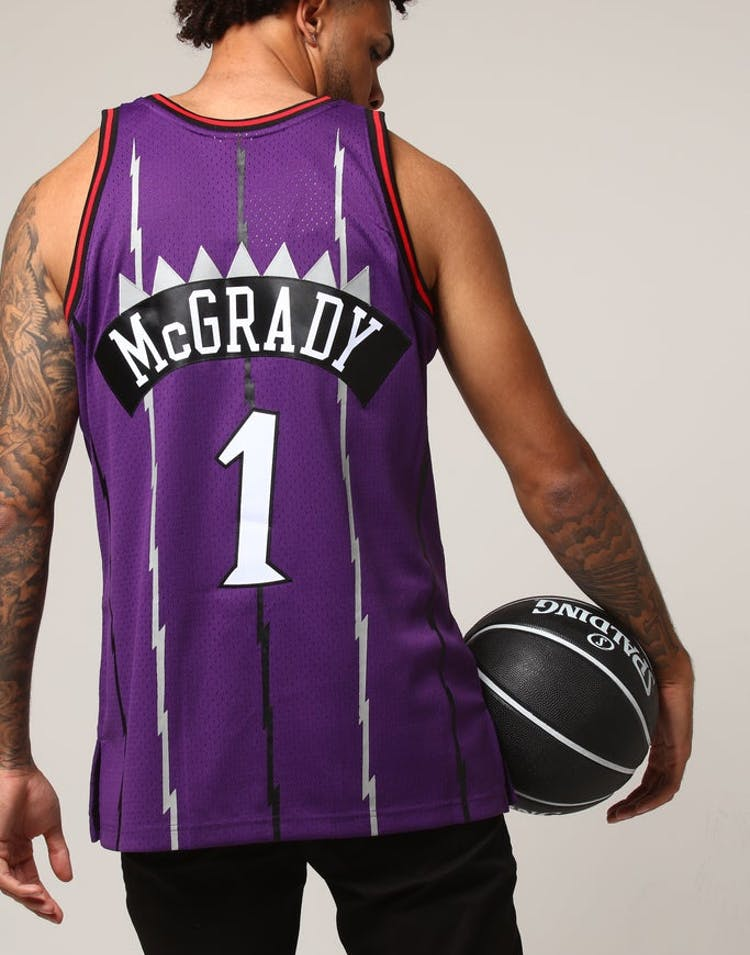 22f898ee27b Mitchell   Ness Toronto Raptors Tracy McGrady  1 NBA Jersey Purple –  Culture Kings