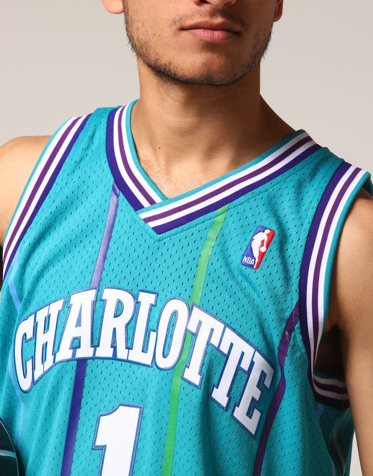 5e8787707c1 Mitchell   Ness Charlotte Hornets Muggsy Bogues  1 NBA Jersey Teal ...