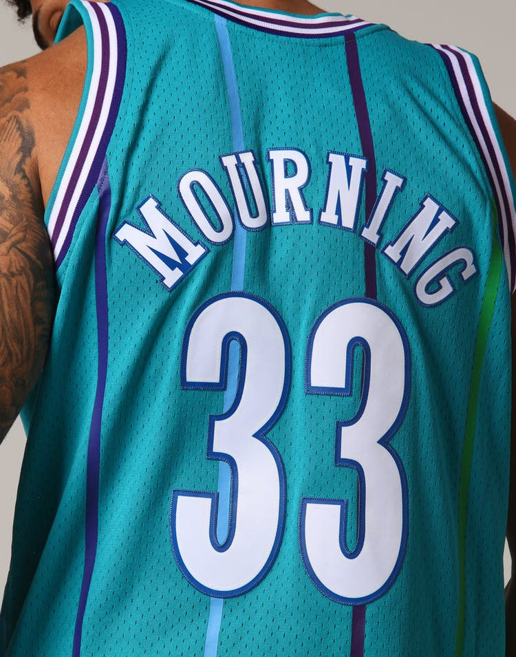 4cd889f9adc7 Mitchell   Ness Charlotte Hornets Alonzo Mourning  33 NBA Jersey Teal