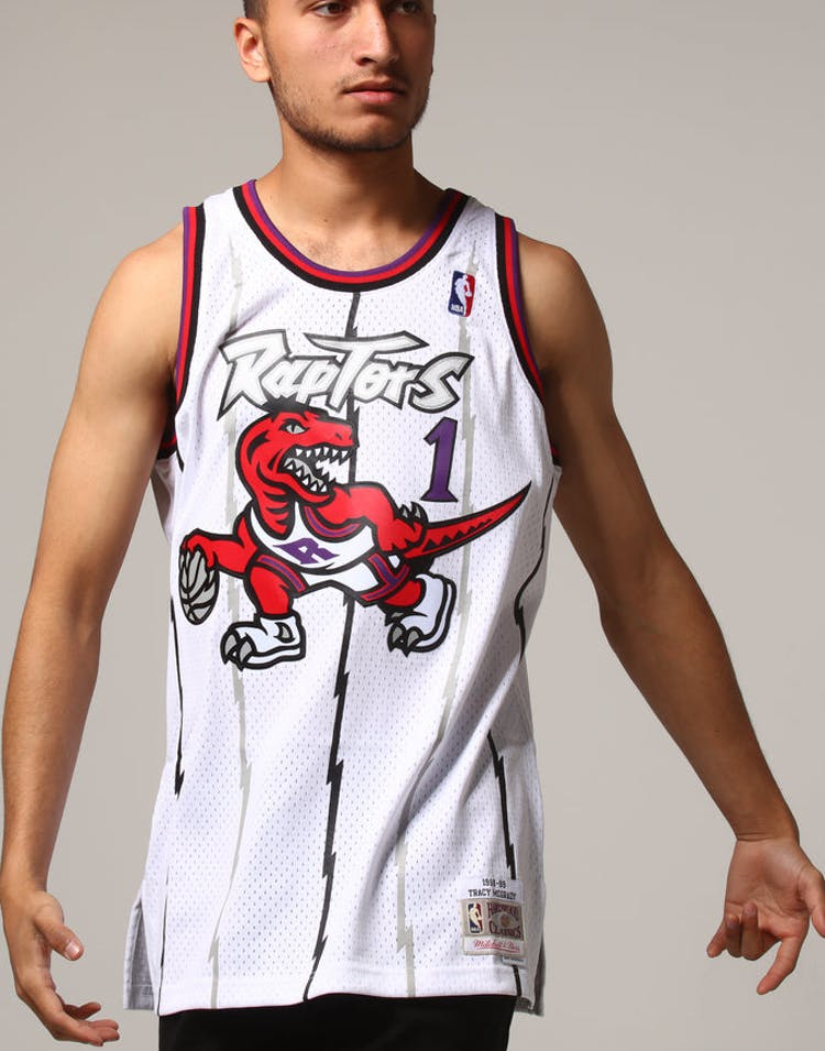 3febc5a55fa Mitchell   Ness Toronto Raptors Tracy McGrady  1 NBA Jersey White – Culture  Kings