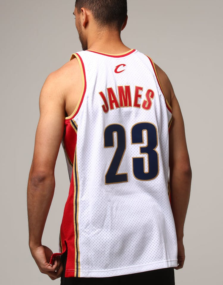 f56cc491975 Mitchell   Ness Cleveland Cavaliers Lebron James  23 NBA Jersey White  –  Culture Kings