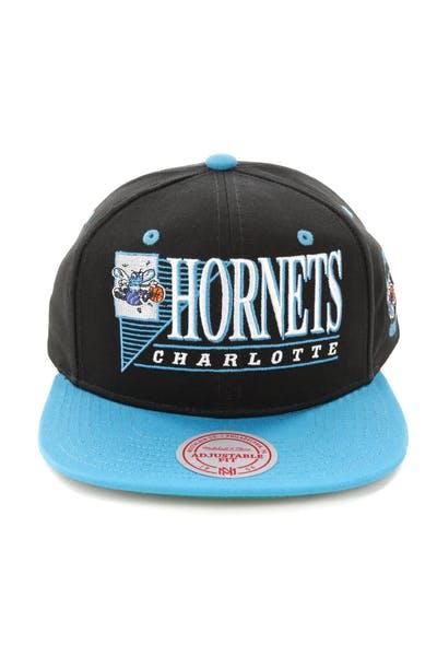 super popular b6a71 0d949 Mitchell   Ness Charlotte Hornets Horizon Snapback Black Teal