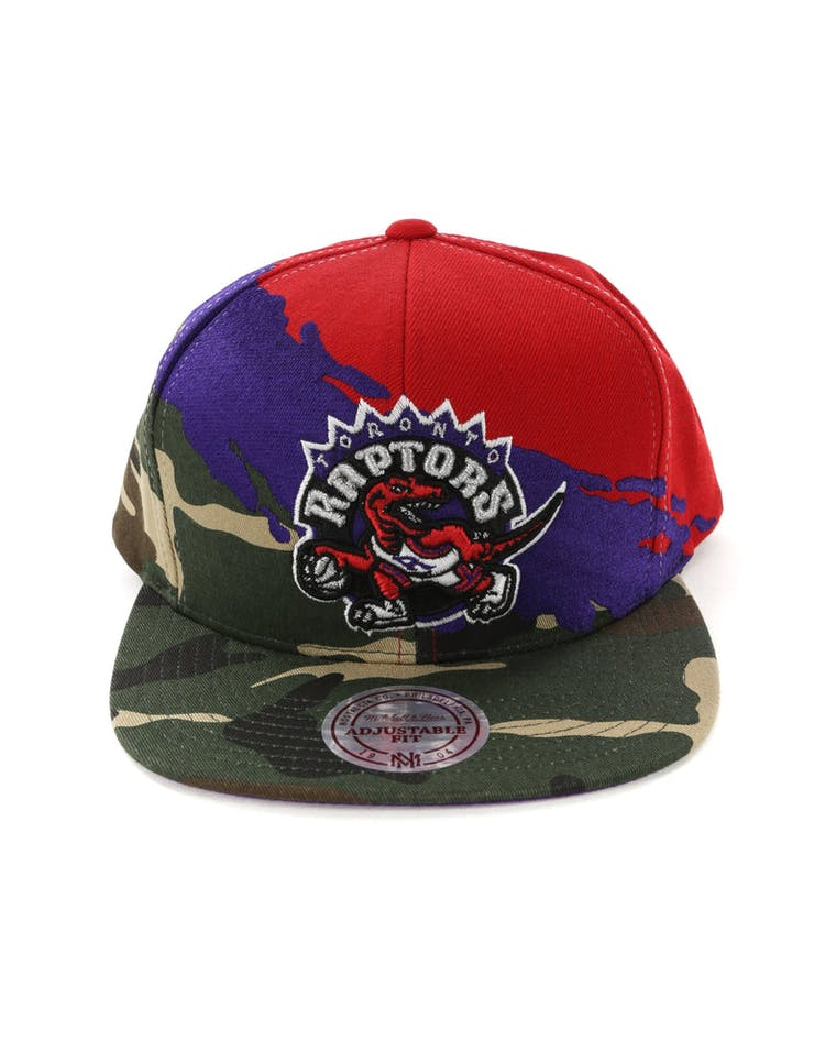 sports shoes 9e5f7 abb76 Mitchell   Ness Toronto Raptors Camo Paintbrush Snapback Purple Red