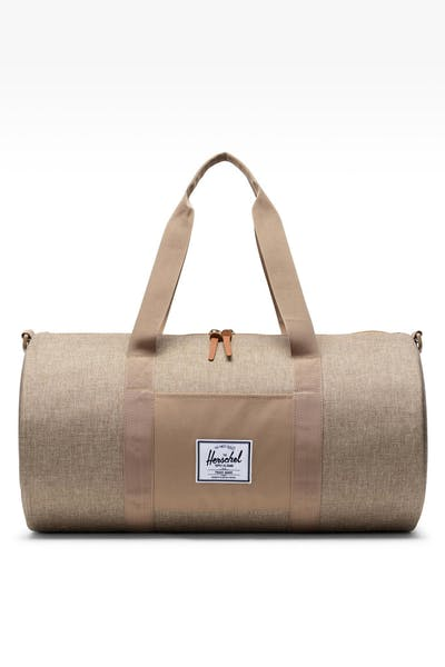 HERSCHEL BAG CO. SUTTON MID-VOLUME CROSSHATCH DUFFLE BAG KELP