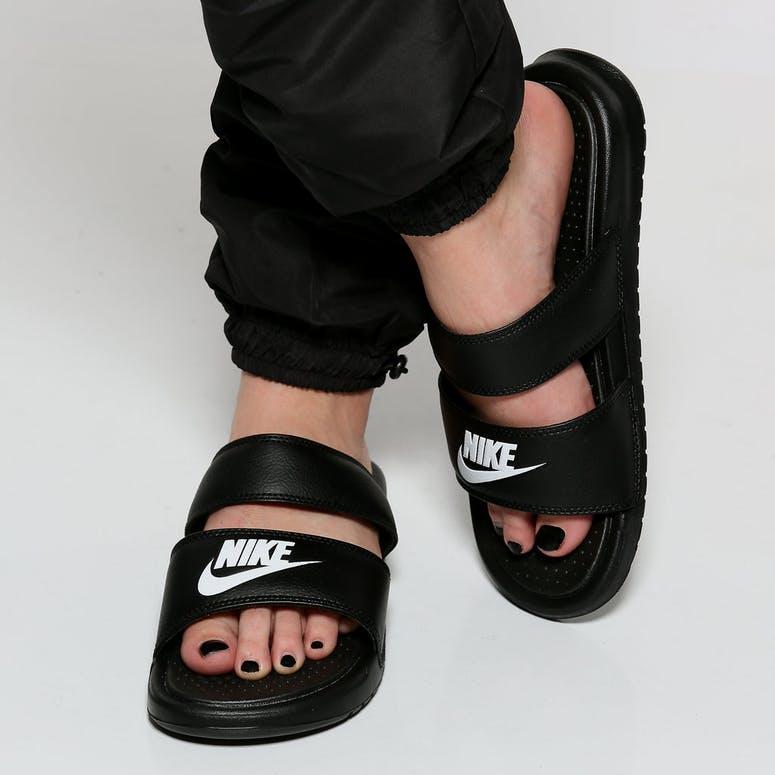 Nike Women s Benassi Duo Ultra Slide Black White  8d1d2a6a3