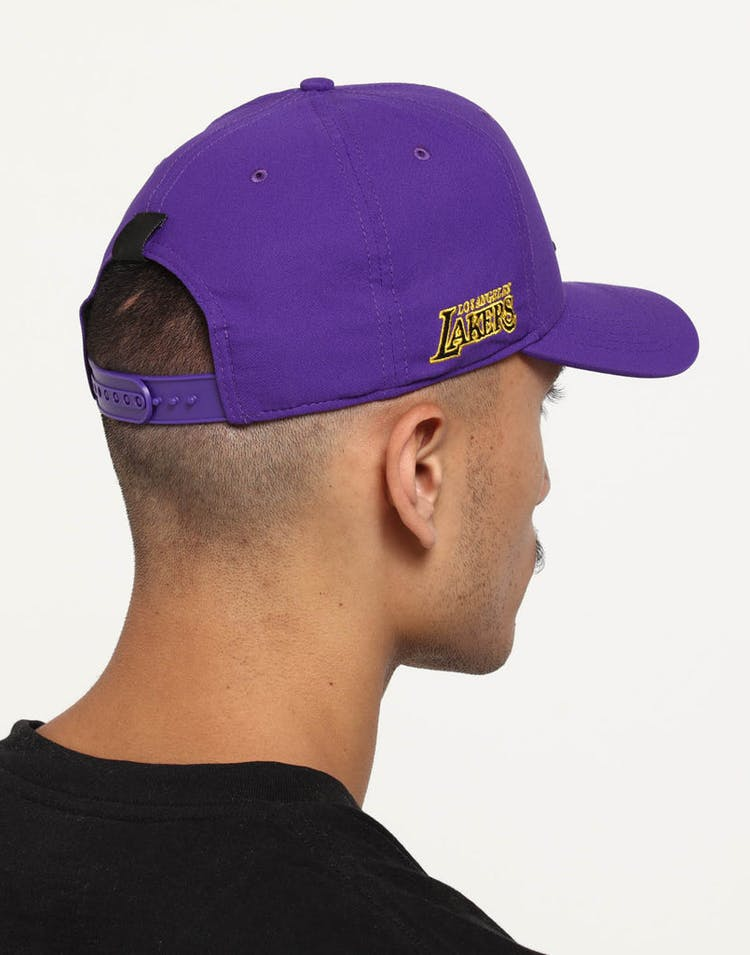 super popular 00954 b6192 Nike Los Angeles Lakers City Edition Dry Arobill Classic99 Snapback Purple
